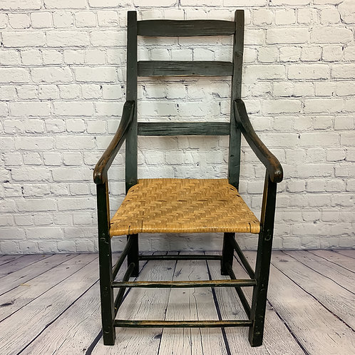 A 19th C Quebec fauteuil / armchair in original dark green crackled paint c1870