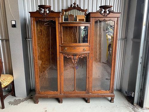 A Canadian fancy oak triple bookcase with mirror