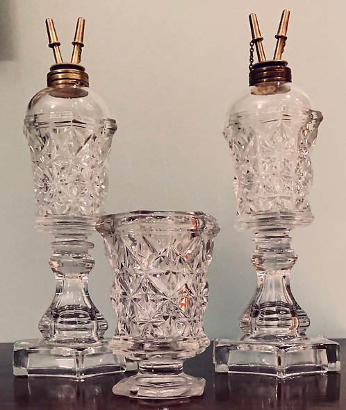 A 19thC pair of colourless Sandwich Star fluid lamps, Boston & Sandwich Glass Co