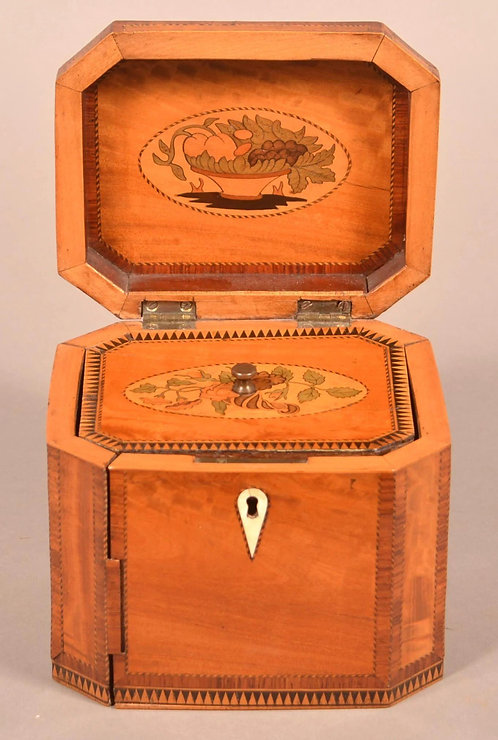 A fine Regency period tea caddy with lovely marquetry