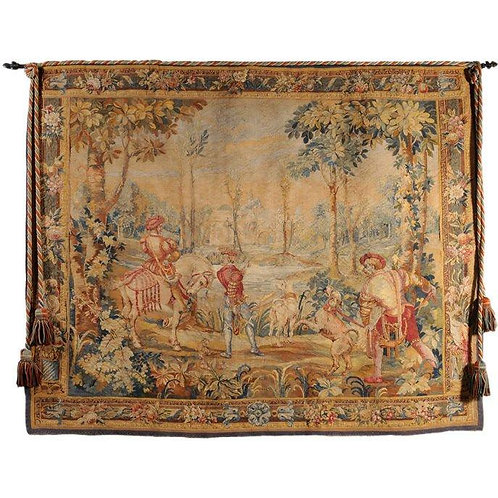 A large Aubusson style tapestry, depicting a hunting party and castle landscape