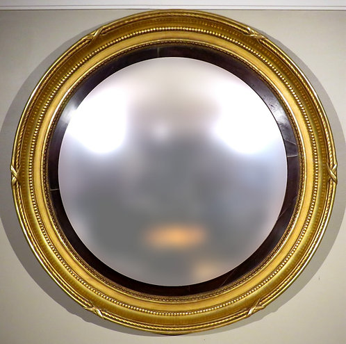 An exceptionally large Georgian giltwood bullseye/butlers mirror, English c1820