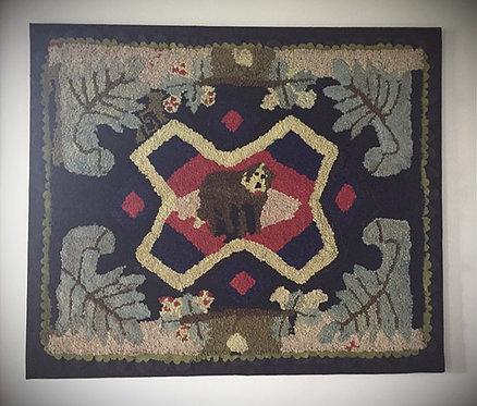 A Canadian folk art hooked rug, Sad Dog with graphic oak leaf & floral border