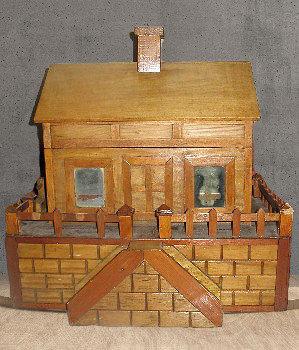 An American folk art keepsake box, in the form of a building