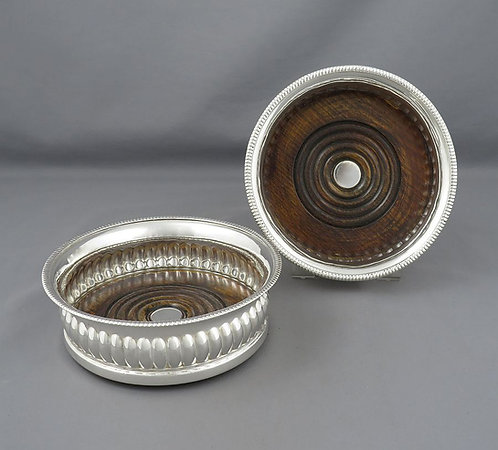 A pair of Georgian sterling silver wine coasters, John Roberts, Sheffield 1809