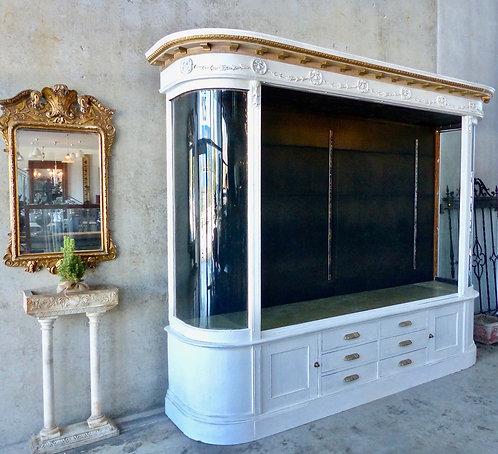 An impressive ornate oak Mercantile showcase with curved glass, c1910