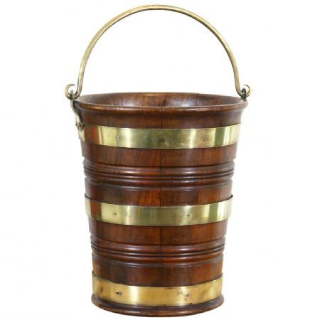 A handsome late 18thc George III period mahogany brass bound peat bucket