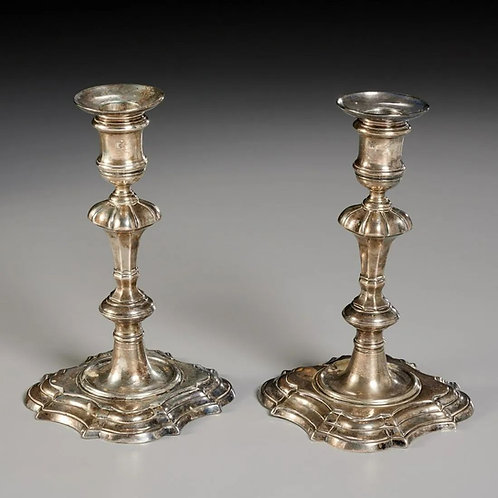 A pair of George II silver candlesticks by William Gould, London, 1744