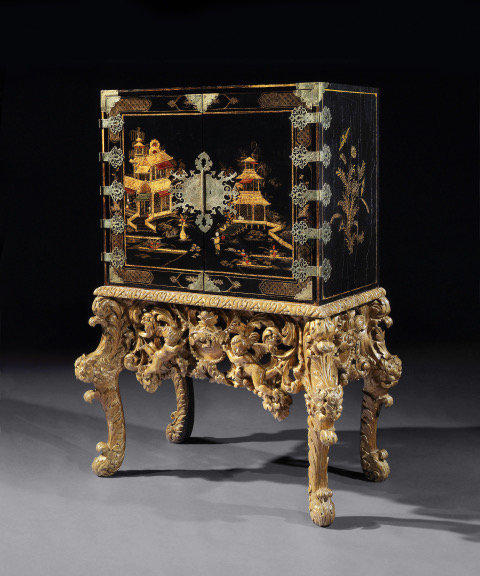 A Charles II black-Japanned & metal-mounted fitted cabinet on giltwood stand