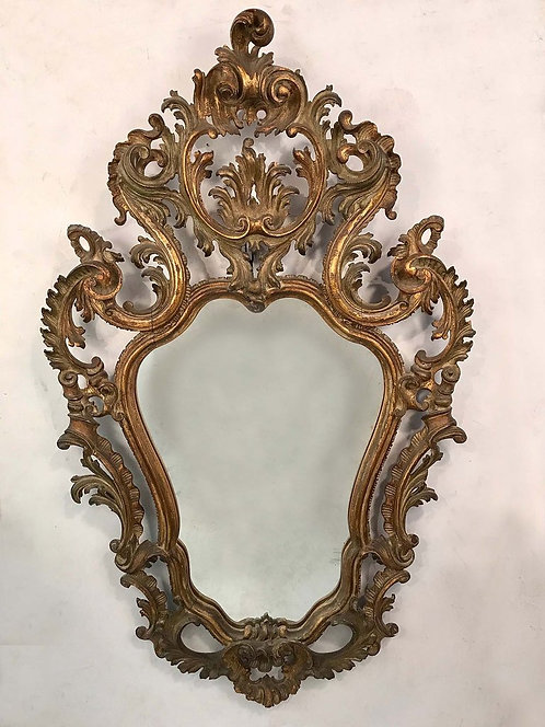 A Baroque style serpentine mirror, acanthus cresting & scrolling foliate forms