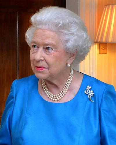 Queen Elizabeth II wearing blue.