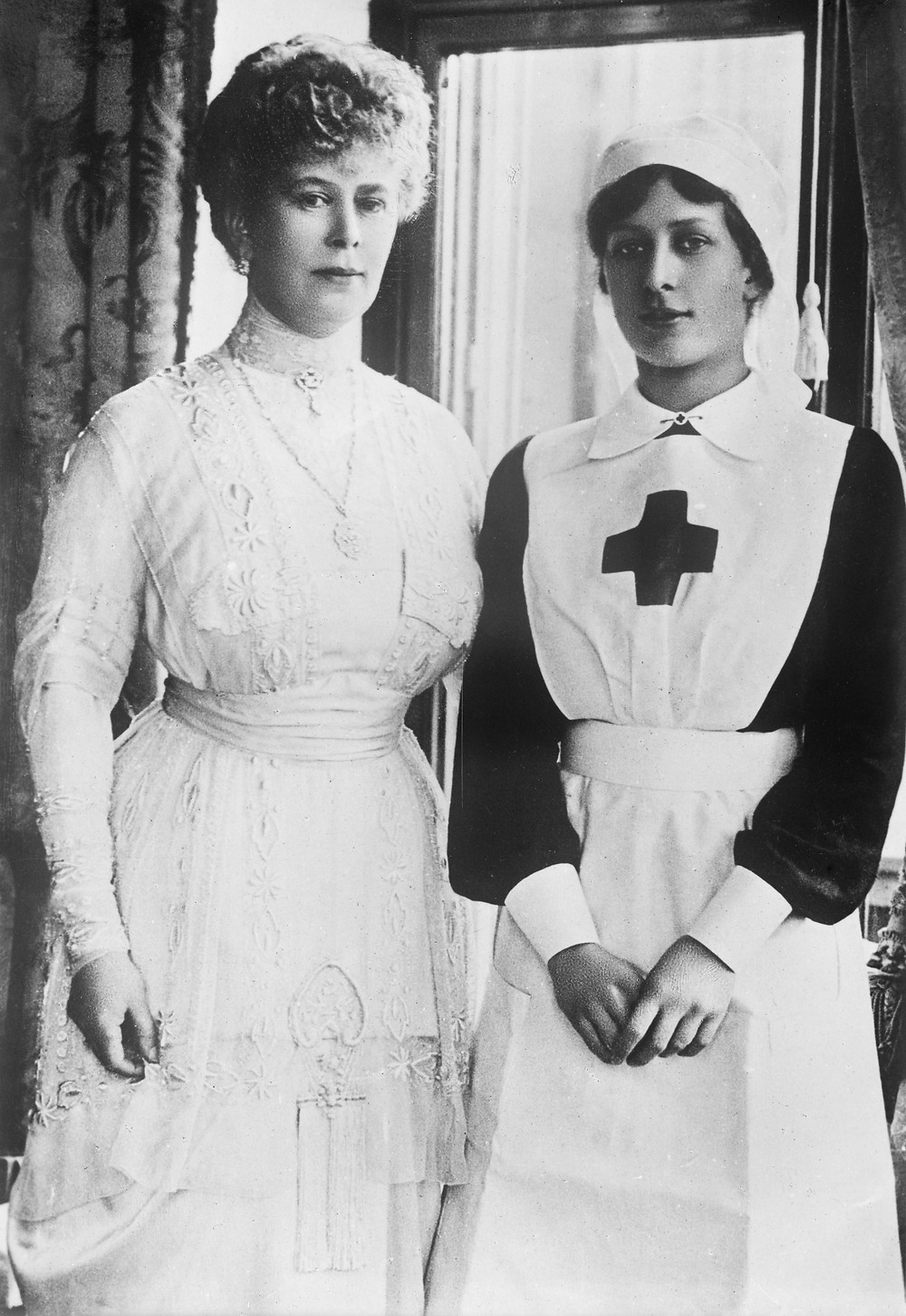 photograph of The Princess Mary (right) with her mother Queen Mary during the First World War. Royal family history, nursing, WWI, British monarchy