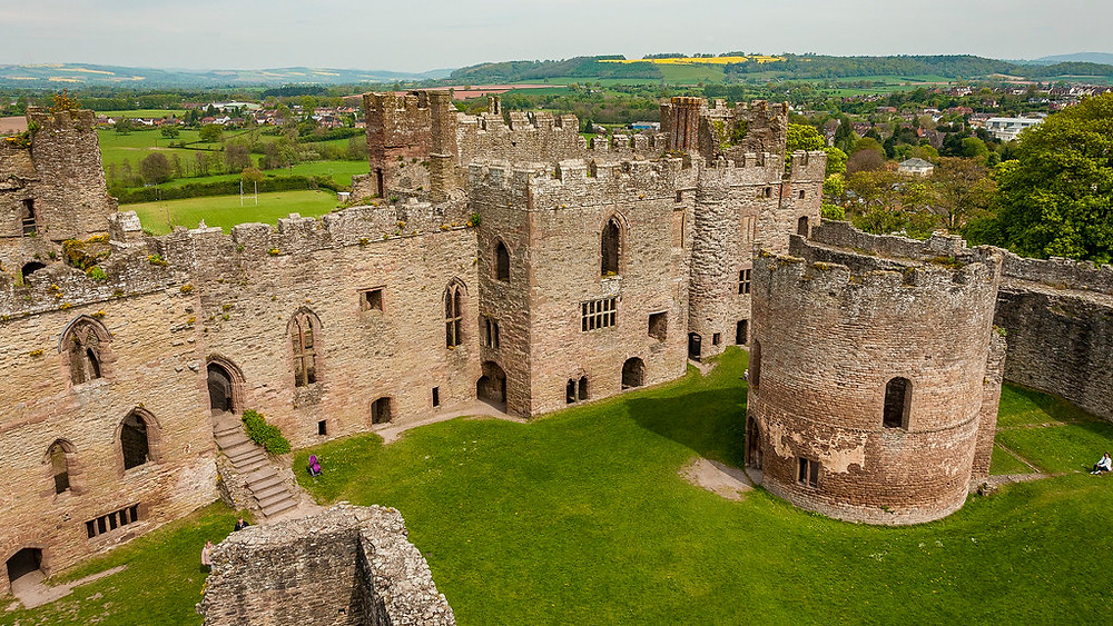 Ludlow Castle is a ruined medieval fortification in the town of the same name in the English county of Shropshire, standing on a promontory overlooking the River Teme. Welsh Marches