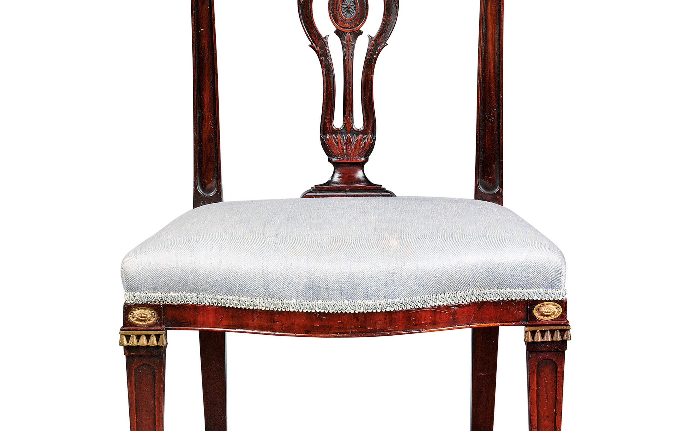 A SET OF NINETEEN GEORGE III MAHOGANY DINING-CHAIRS   CIRCA 1775, IN THE MANNER OF JOHN LINNELL
