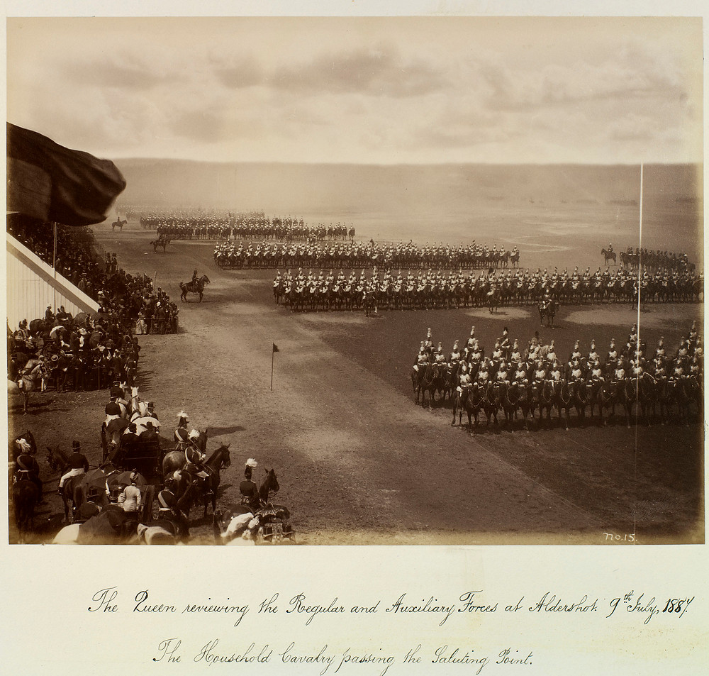 Queen Victoria reviewing the Regular & Auxiliary Forces at Aldershot, 9 July 1887. The Household Cavalry passing the Saluting point. 9 Jul 1887.  Royal Collection Trust/(c) Her Majesty Queen Elizabeth II 2019