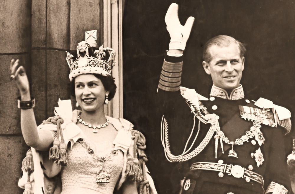 HM Queen Elizabeth II and HRH The Duke of Edinburgh waving to the crowds from the balcony of Buckingham Palace after the Coronation Ceremony in Westminster Abbey,
