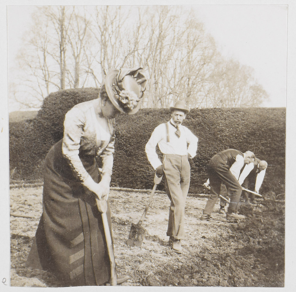 King George V takes a breather, while Queen Mary digs potatoes in Windsor,1917