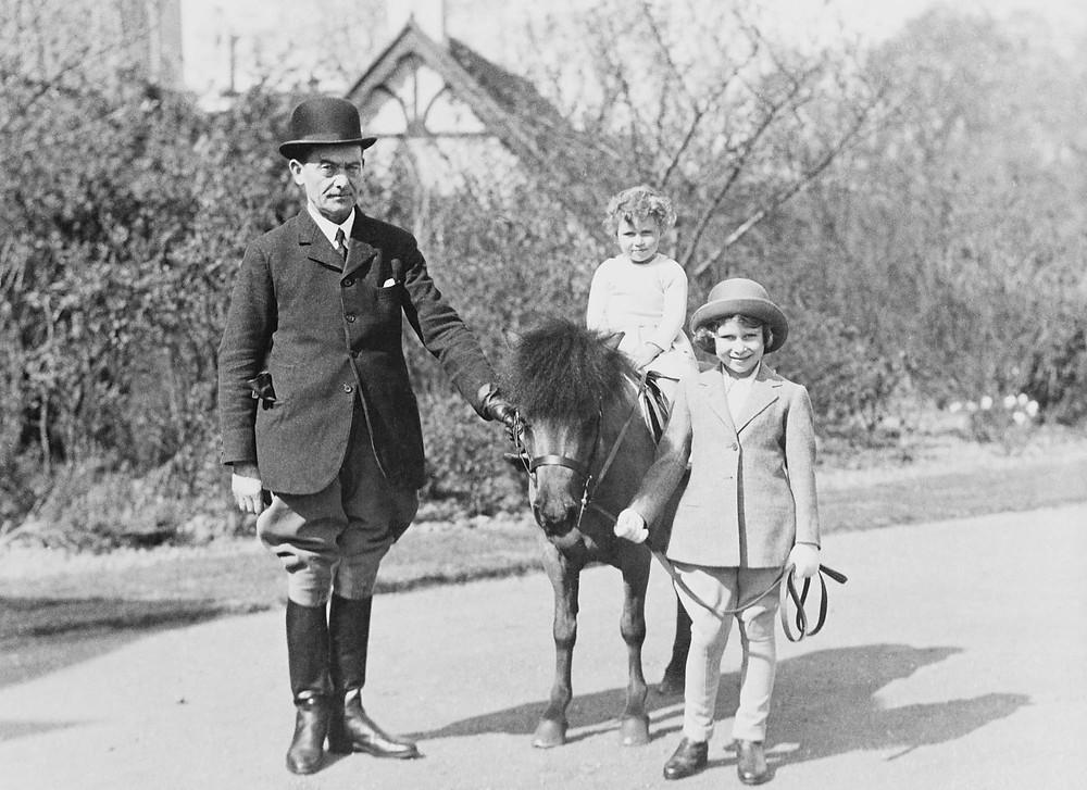 "Princess Elizabeth of York with Princess Margaret of York, ""Peggy"" and Mr Owen, the groom c.1933-4."