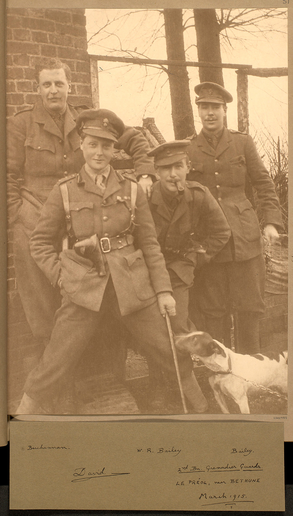 Prince of Wales, later King Edward VIII (1894-1972) posing with a dog and three other soldiers from the 2nd Battalion, Grenadier Guards. March 1915