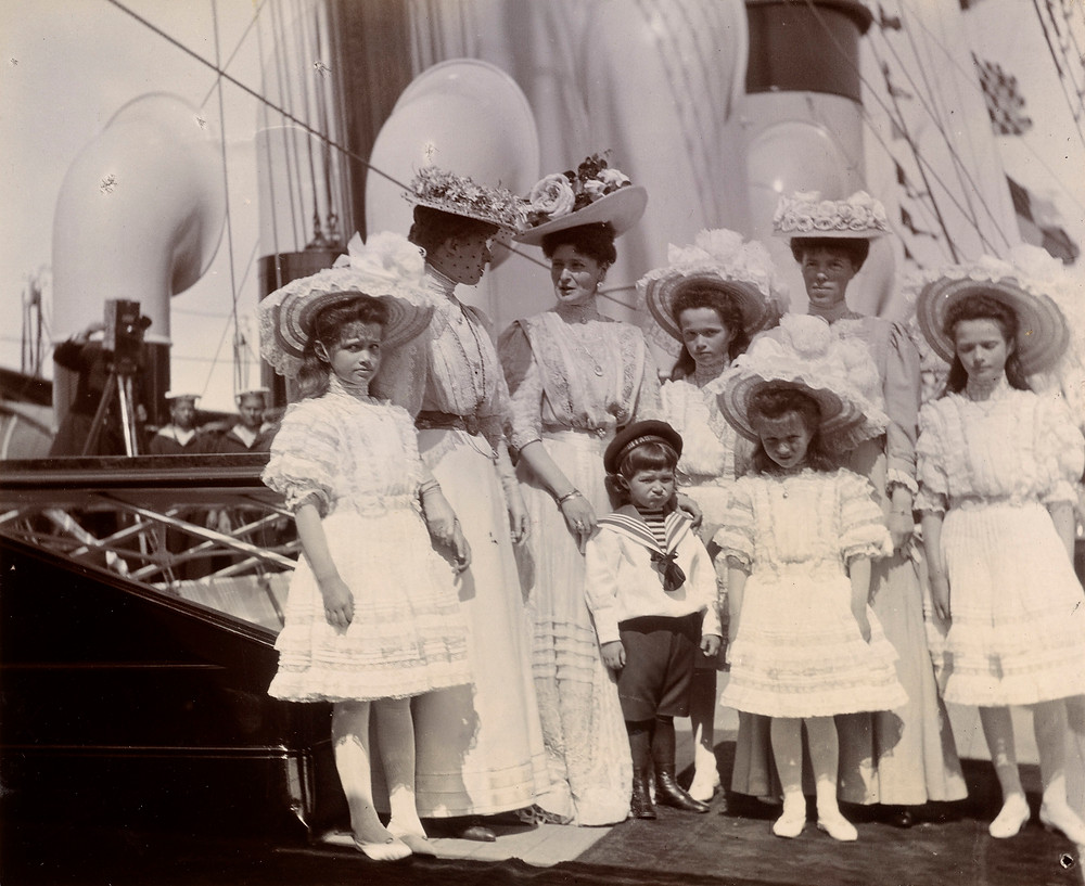 Photograph of Grand Duchess Marie, Princess Victoria talking to Empress Alexandra, Dowager Queen Maria Feodorovna, Tsarveitch Alexis and Grand Duchesses Olga, Anastasia, Alexandrovna and Tatiana. on board the Imperial Yacht Standart, at Reval, Russia (now Tallinn, Estonia) Russian Royalty