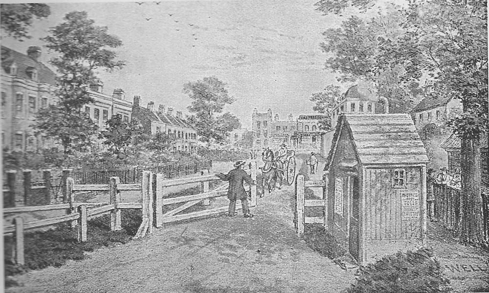 A victorian gatehouse and gate