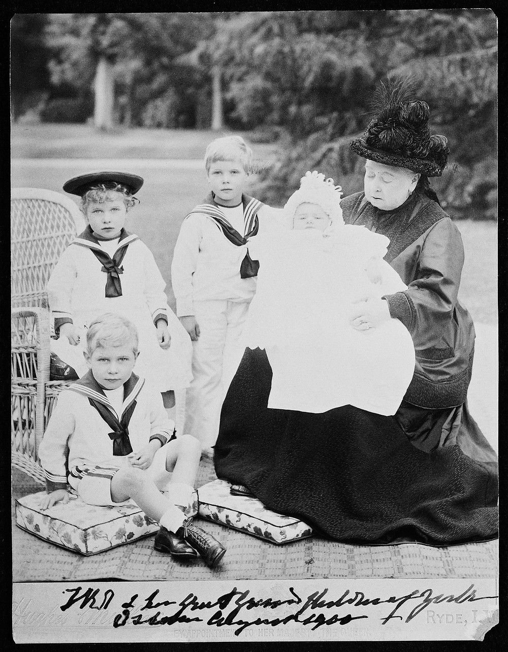 Photograph of Queen Victoria in the garden at Osborne with four of her great-grandchildren; Prince Edward (1894-1972); Prince Albert (1895-1952); Princess Mary (1897-1965) and Prince Henry of York (1900-1974)
