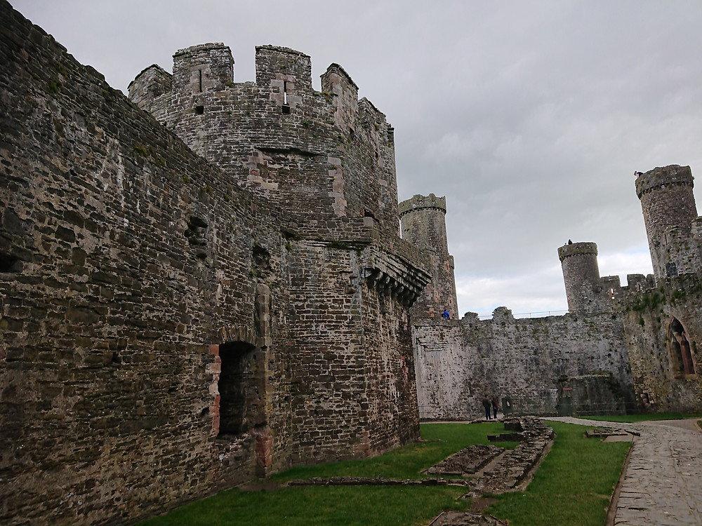 Inside the castle walls, Conwy Castle, Conwy, North Wales. The tower on the left is the Kitchen Tower. Medieval castle stronghold, built by Edward I, King of England