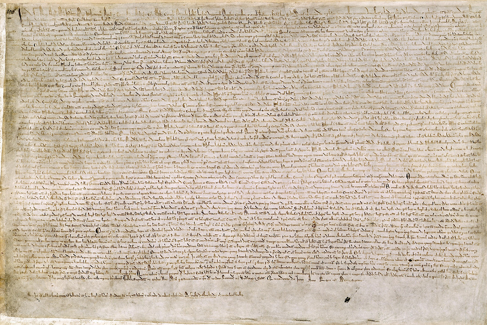 """The Magna Carta (originally known as the Charter of Liberties) of 1215, written in iron gall ink on parchment in medieval Latin, using standard abbreviations of the period, authenticated with the Great Seal of King John. The original wax seal was lost over the centuries. This document is held at the British Library and is identified as """"British Library Cotton MS Augustus II.106""""."""