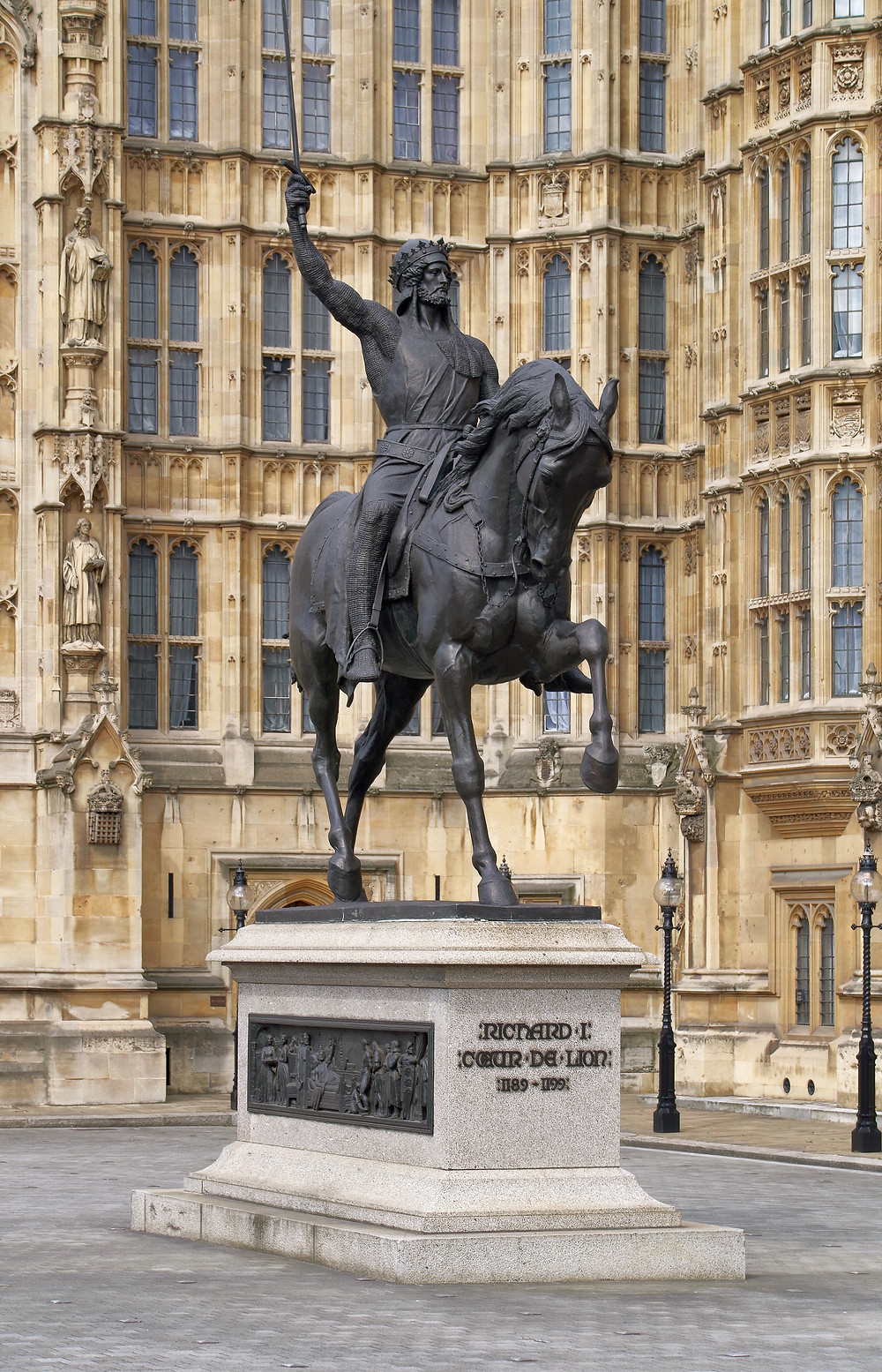 Richard Coeur de Lion by Carlo Marochetti, an equestrian statue depicting Richard I of England. After its model was displayed in the Great Exhibition of 1851, a bronze casting was installed outside the New Palace of Westminster in 1860.