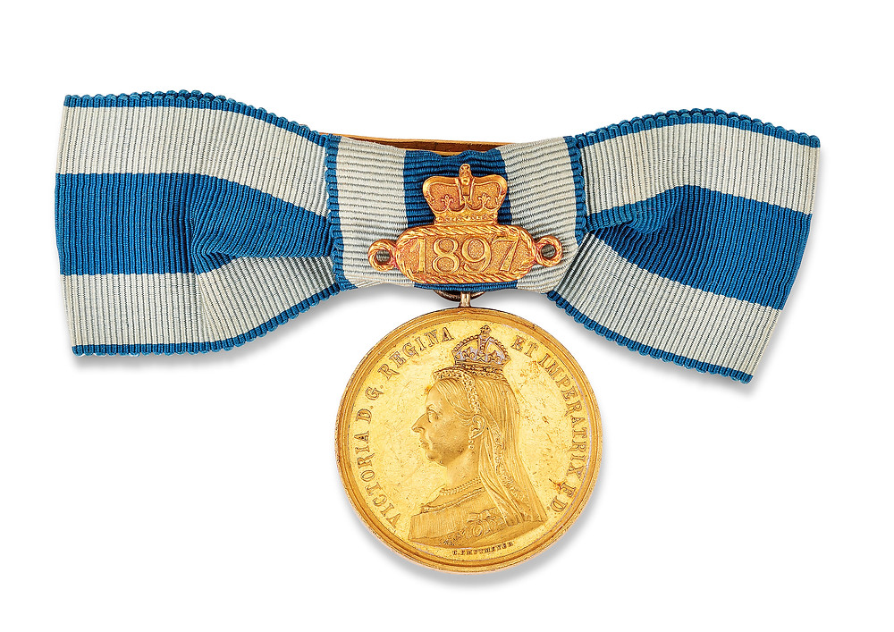 QUEEN VICTORIA, GOLDEN JUBILEE GOLD MEDAL 1887 with 1897 bar in gold for the Diamond Jubilee, with bow denoting to be worn by a lady, contact marks, good very fine. british royal family