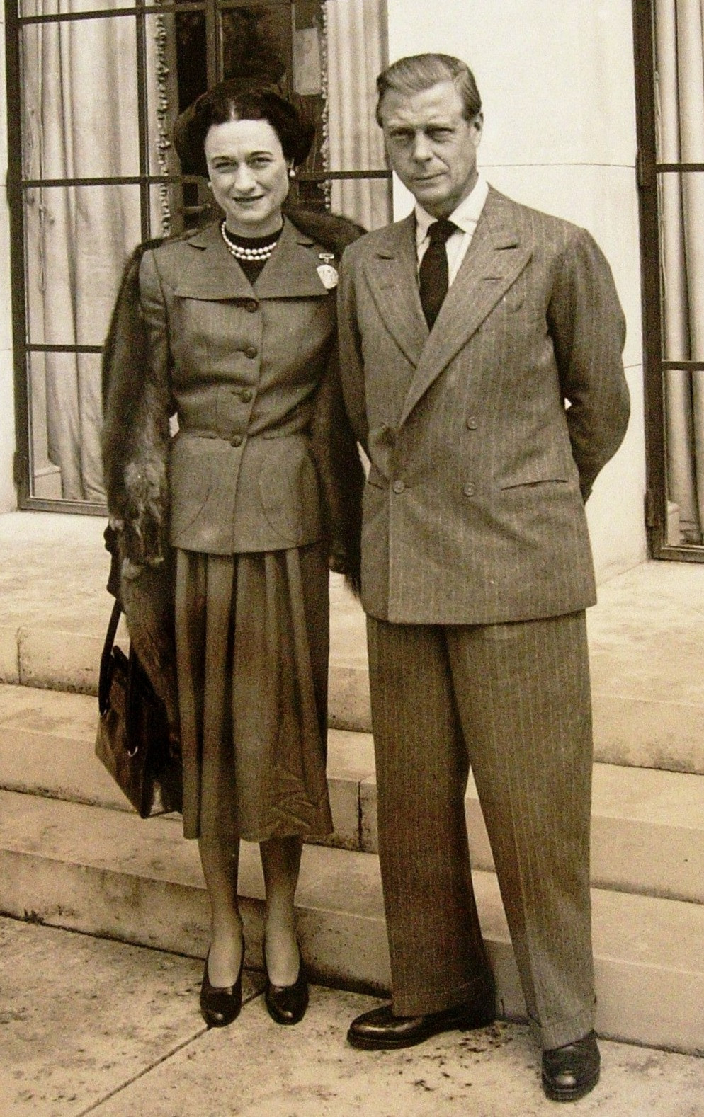 Duke and Duchess of Windsor standing outside Charters, Sunninghill during visit to England, 16th May 1947. Residence loaned to them by Mrs Frank Parkinson. Duchess wears fur stole around her shoulders.