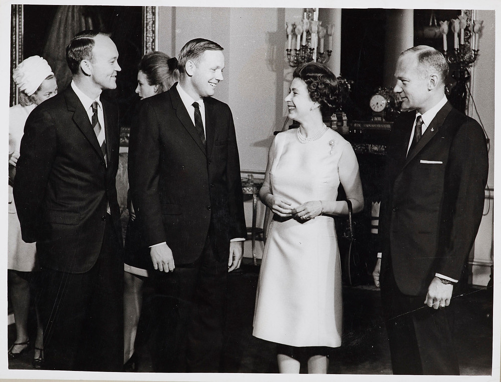 The Queen receives Astronauts at Buckingham Palace 15 Oct 1969. Photograph of HM the Queen (b. 1926) talking to Astronauts (l-r): Mike Collins, Neil Armstrong and Edwin Aldrin during their visit to Buckingham Palace. The Astronauts were visiting Britain during a short trip.