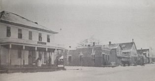 West Side of Main Street before the 1898 Fire. (Hotel on the Left is currently the Janesville Tap)