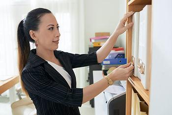 Secretary-working-with-documents-466420.jpg