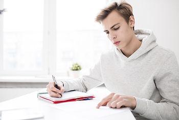 Student-writing-essay-561133.JPG