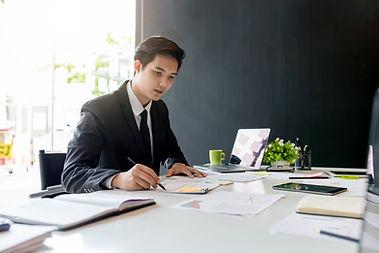 Accountant Working at Desk.jpg