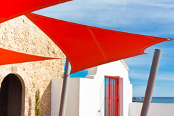 Bright Red Sunshade at White House and Blue Sky Background