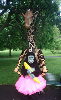 Giraffe puppet and gorilla costume