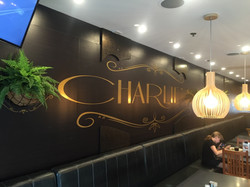 GOLD SIGNAGE ON WALL WRAP