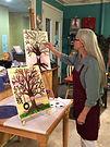 Traci painting Tree with Heart.jpg