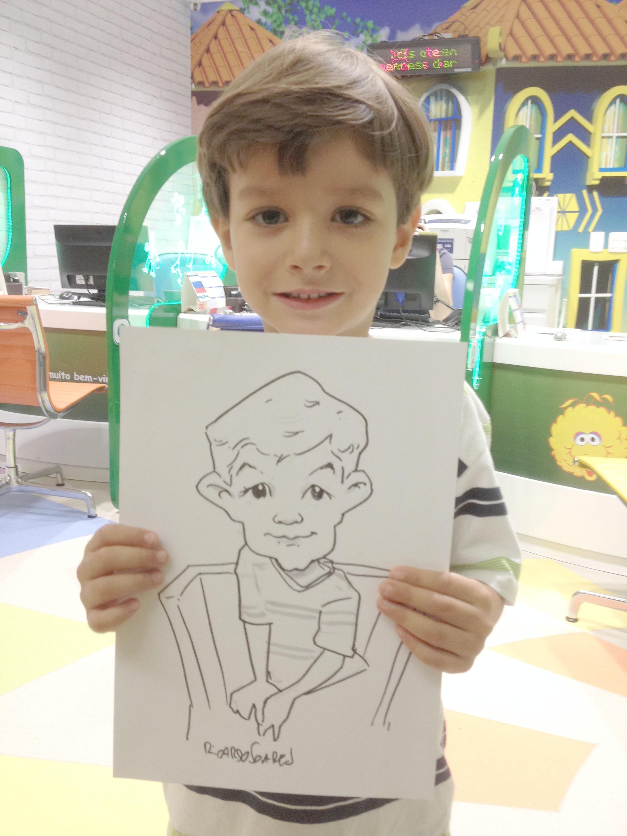 Caricatura ao viv de menino
