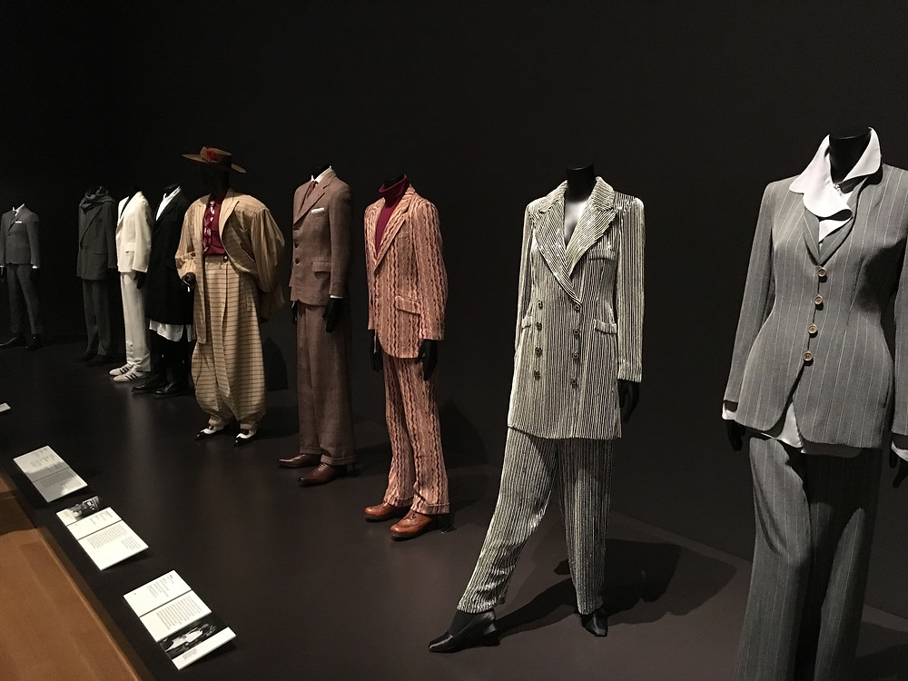 Suits on display at the MOMA
