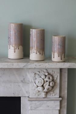 Three crystal glazed cylinder forms