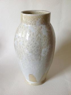 larger white fluted vessel