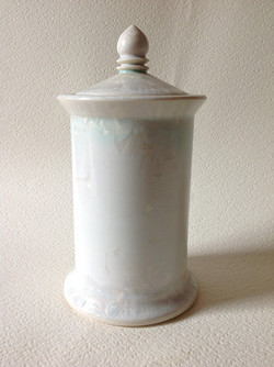 white lidded jar