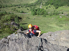 lady climbing in Gle Nevis
