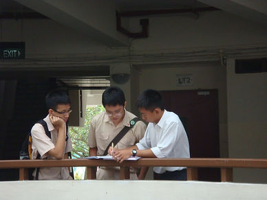 Mr Quek Wee Tong guiding students from HCI