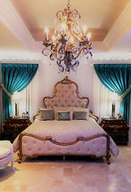 Traditional Bedroom Design, Chandelier, Custom Drapery, Handcarved Tufted Bed, Custom Bollister Pillows, Travertine Flooring, Uttermost Accessories, Ceiling Riser