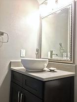 Vessel Sink atop Quartz and Custom Vanity, Uttermost Accessories, Delta Bathroom Products