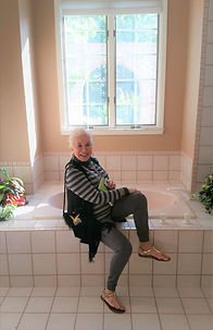 Anita and her bathroom before the remodel